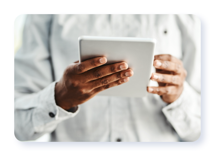 Person holding a tablet device
